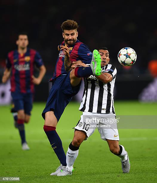 Carlos Tevez of Juventus and Gerard Pique of Barcelona battle for the ball during the UEFA Champions League Final between Juventus and FC Barcelona...
