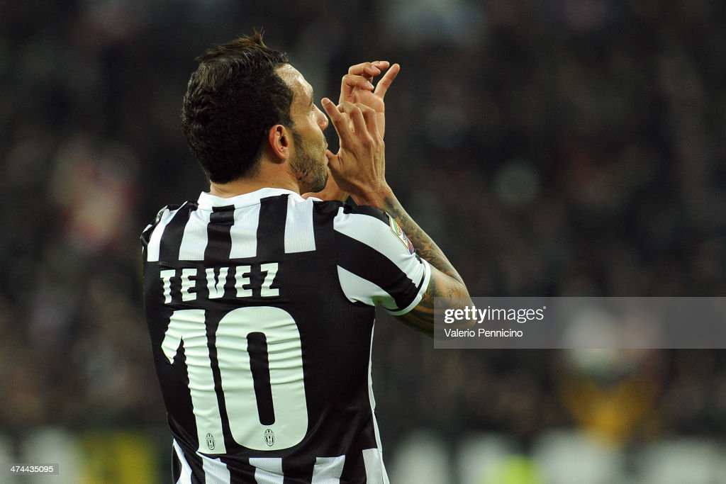 <a gi-track='captionPersonalityLinkClicked' href=/galleries/search?phrase=Carlos+Tevez&family=editorial&specificpeople=220555 ng-click='$event.stopPropagation()'>Carlos Tevez</a> of Juventus celebrates after scoring the opening goal during the Serie A match between Juventus and Torino FC at Juventus Arena on February 23, 2014 in Turin, Italy.
