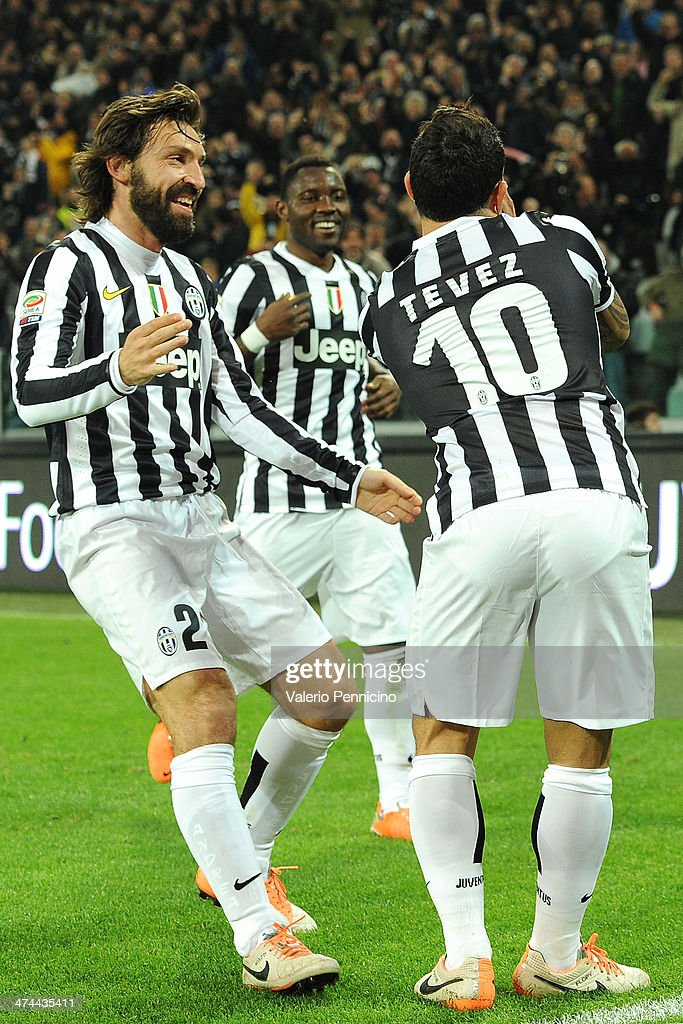 <a gi-track='captionPersonalityLinkClicked' href=/galleries/search?phrase=Carlos+Tevez&family=editorial&specificpeople=220555 ng-click='$event.stopPropagation()'>Carlos Tevez</a> (R) of Juventus celebrates after scoring the opening goal with <a gi-track='captionPersonalityLinkClicked' href=/galleries/search?phrase=Andrea+Pirlo&family=editorial&specificpeople=198835 ng-click='$event.stopPropagation()'>Andrea Pirlo</a> (L) and <a gi-track='captionPersonalityLinkClicked' href=/galleries/search?phrase=Kwadwo+Asamoah&family=editorial&specificpeople=4376914 ng-click='$event.stopPropagation()'>Kwadwo Asamoah</a> during the Serie A match between Juventus and Torino FC at Juventus Arena on February 23, 2014 in Turin, Italy.