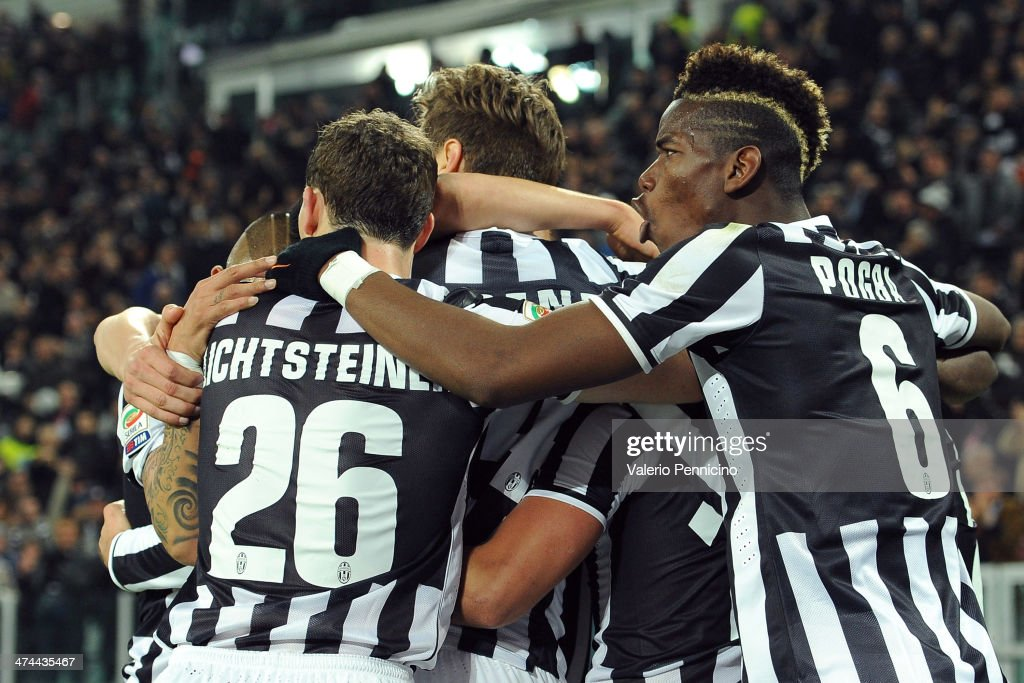 <a gi-track='captionPersonalityLinkClicked' href=/galleries/search?phrase=Carlos+Tevez&family=editorial&specificpeople=220555 ng-click='$event.stopPropagation()'>Carlos Tevez</a> (C) of Juventus celebrates after scoring the opening goal with team-mate during the Serie A match between Juventus and Torino FC at Juventus Arena on February 23, 2014 in Turin, Italy.