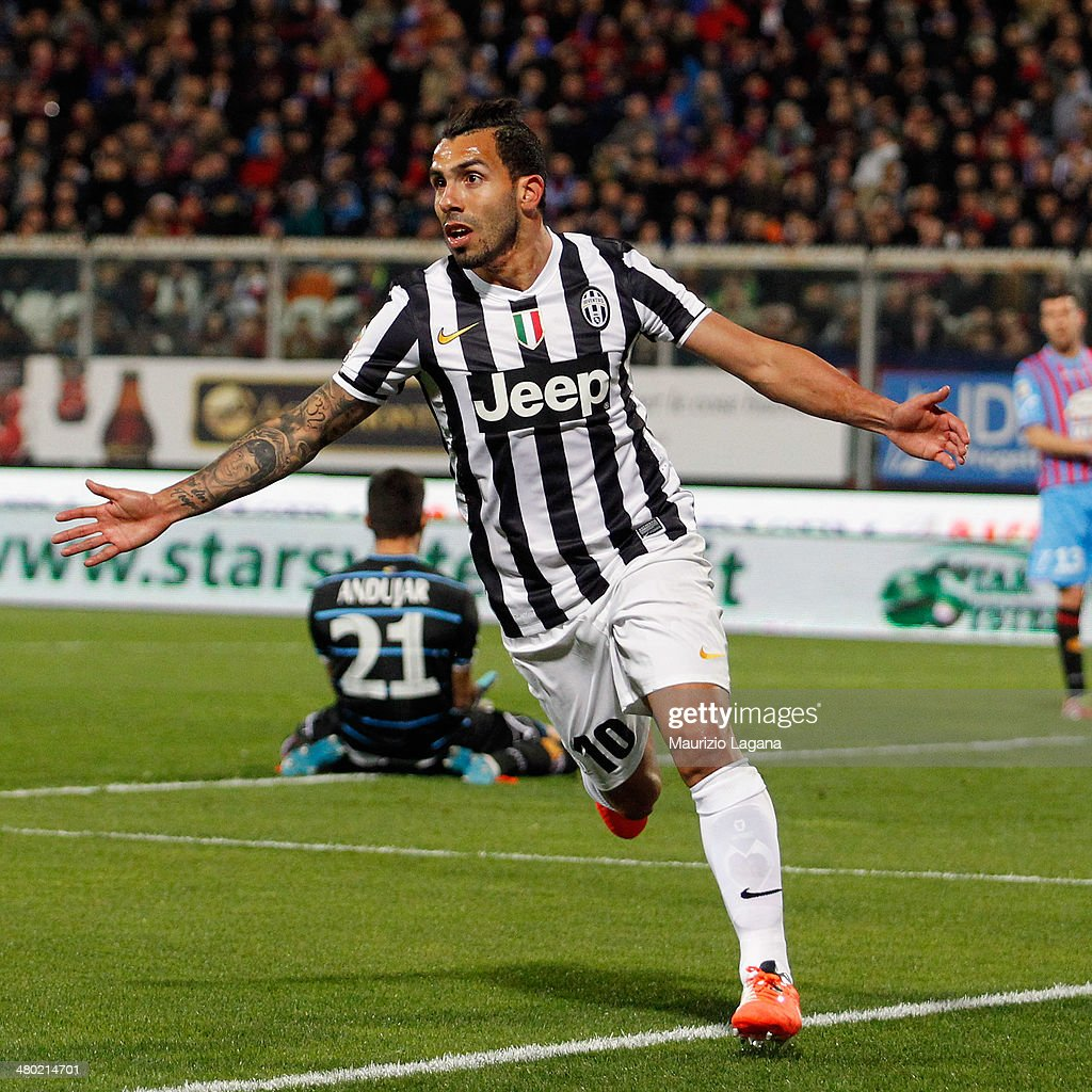 Carlos Tevez of Juventus celebrates after scoring the opening goal during the Serie A match between Calcio Catania and Juventus at Stadio Angelo...