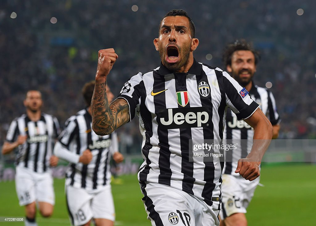 <a gi-track='captionPersonalityLinkClicked' href=/galleries/search?phrase=Carlos+Tevez&family=editorial&specificpeople=220555 ng-click='$event.stopPropagation()'>Carlos Tevez</a> of Juventus celebrates as he scores their second goal from a penalty during the UEFA Champions League semi final first leg match between Juventus and Real Madrid CF at Juventus Arena on May 5, 2015 in Turin, Italy.
