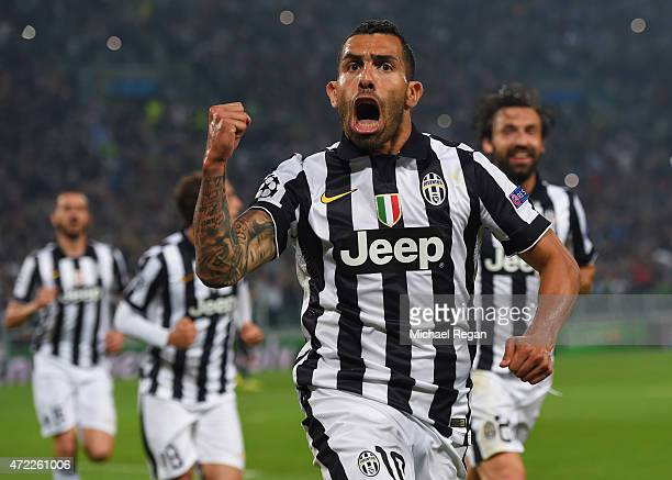 Carlos Tevez of Juventus celebrates as he scores their second goal from a penalty during the UEFA Champions League semi final first leg match between...
