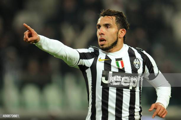 Carlos Tevez of Juventus celebrates his second goal during the Serie A match between Juventus and US Sassuolo Calcio at Juventus Arena on December 15...