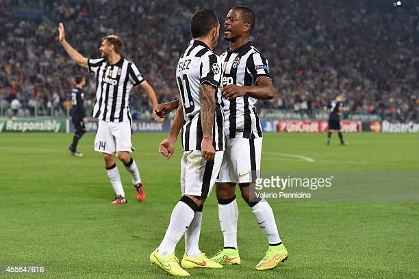 Carlos Tevez of Juventus celebrates the opening goal with teammates Patrice Evra during the UEFA Champions League Group A match between Juventus and...