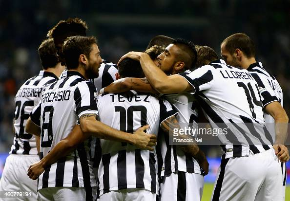 Carlos Tevez of Juventus celebrates with teammates after scoring his team's first goal during the 2014 Italian Super Cup match between Juventus FC v...