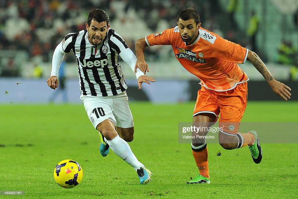 Carlos Tevez (L) of Juventus competes with Danilo Larangeira of Udinese Calcio during the Serie A match between Juventus and Udinese Calcio at Juventus Arena on December 1, 2013 in Turin, Italy.