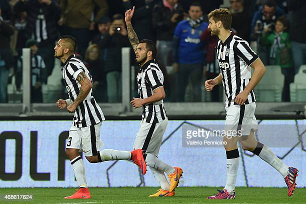 Carlos Tevez of Juventus FC celebrates after scoring the opening goal during the Serie A match between Juventus FC and Empoli FC at Juventus Arena on...