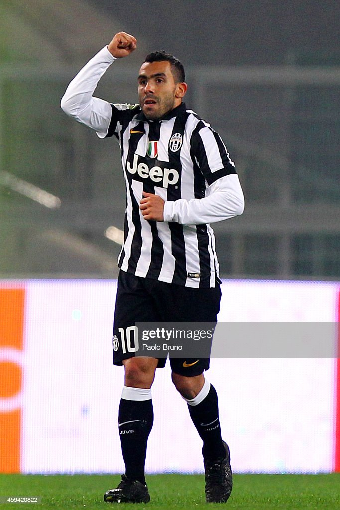 <a gi-track='captionPersonalityLinkClicked' href=/galleries/search?phrase=Carlos+Tevez&family=editorial&specificpeople=220555 ng-click='$event.stopPropagation()'>Carlos Tevez</a> of Juventus FC celebrates after scoring the second team's goal during the Serie A match between SS Lazio and Juventus FC at Stadio Olimpico on November 22, 2014 in Rome, Italy.