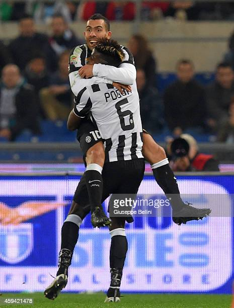 Carlos Tevez of Juventus FC celebrates with Paul Pogba after scoring the goal 02 during the Serie A match between SS Lazio and Juventus FC at Stadio...