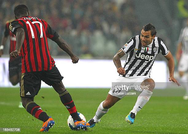 Carlos Tevez of Juventus FC competes for the ball with Cristian Zapata of AC Milan during the Serie A match between Juventus FC and AC Milan at...