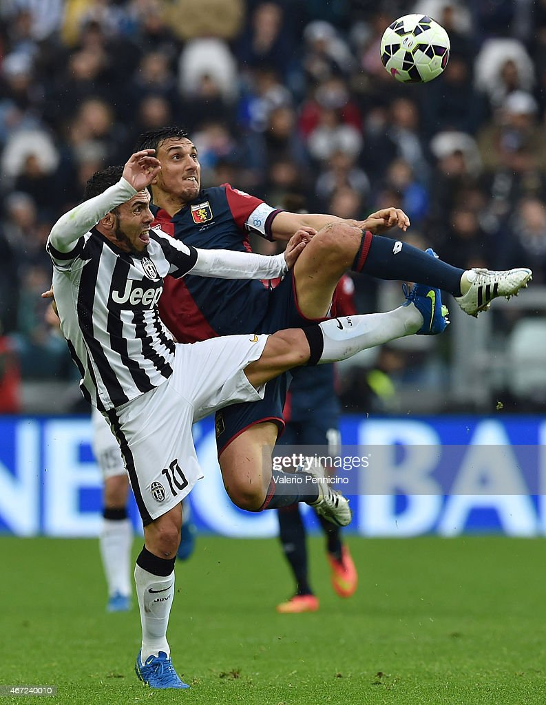 Carlos Tevez of Juventus FC competes with Nicolas Burdisso of Genoa CFC during the Serie A match between Juventus FC and Genoa CFC at Juventus Arena...