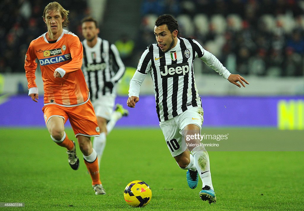 Carlos Tevez of Juventus in action during the Serie A match between Juventus and Udinese Calcio at Juventus Arena on December 1, 2013 in Turin, Italy.