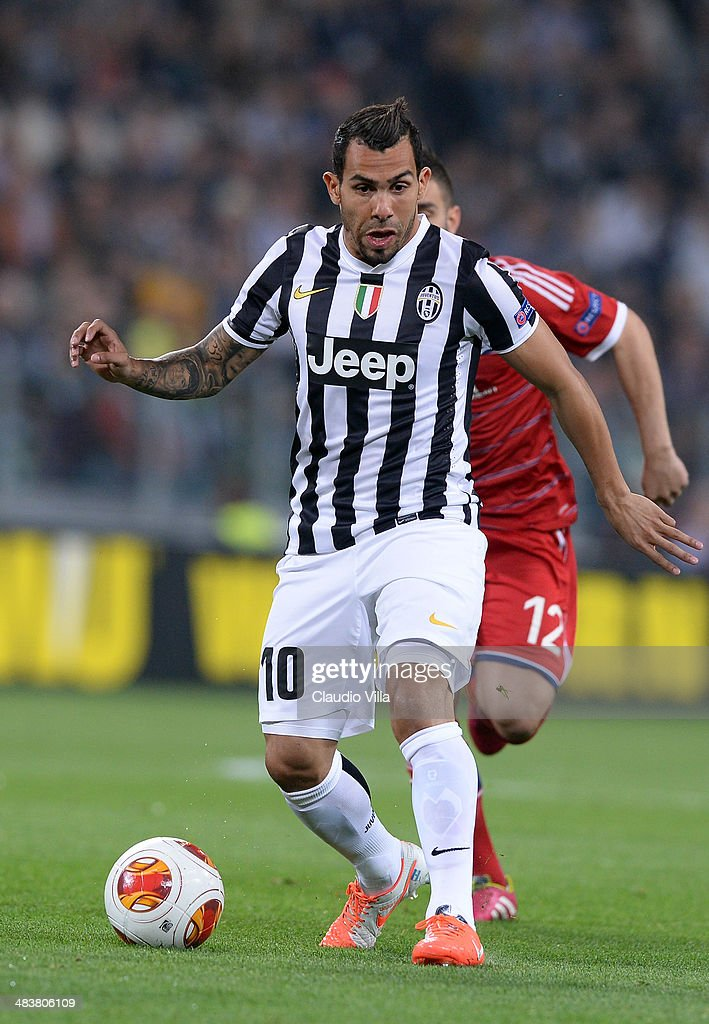 Carlos Tevez of Juventus in action during the UEFA Europa League quarter final match between Juventus and Olympique Lyonnais at Juventus Arena on April 10, 2014 in Turin, Italy.