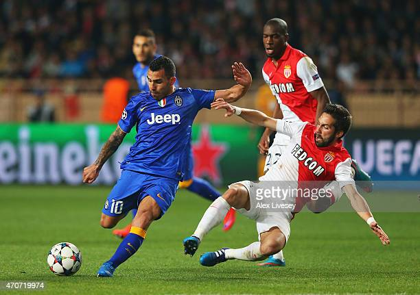 Carlos Tevez of Juventus is challenged by Joao Moutinho of Monaco as he shoots during the UEFA Champions League quarterfinal second leg match between...