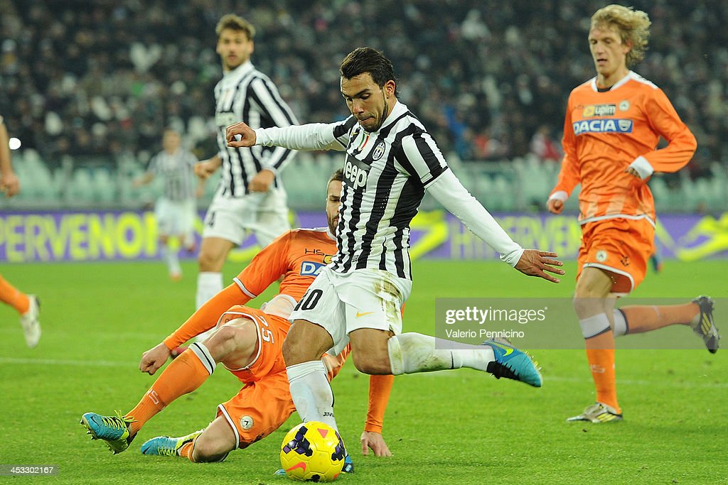 <a gi-track='captionPersonalityLinkClicked' href=/galleries/search?phrase=Carlos+Tevez&family=editorial&specificpeople=220555 ng-click='$event.stopPropagation()'>Carlos Tevez</a> (R) of Juventus is challenged by <a gi-track='captionPersonalityLinkClicked' href=/galleries/search?phrase=Thomas+Heurtaux&family=editorial&specificpeople=7140770 ng-click='$event.stopPropagation()'>Thomas Heurtaux</a> of Udinese Calcio during the Serie A match between Juventus and Udinese Calcio at Juventus Arena on December 1, 2013 in Turin, Italy.