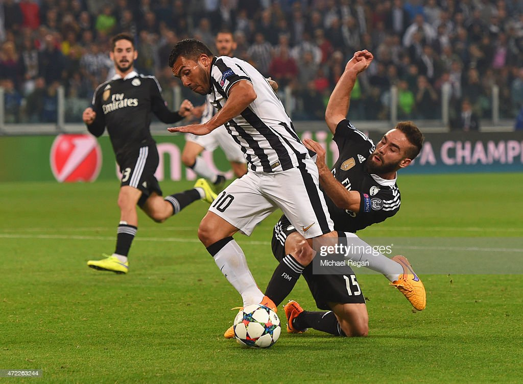 <a gi-track='captionPersonalityLinkClicked' href=/galleries/search?phrase=Carlos+Tevez&family=editorial&specificpeople=220555 ng-click='$event.stopPropagation()'>Carlos Tevez</a> of Juventus is fouled by Daniel Carvajal of Real Madrid CF for a penalty during the UEFA Champions League semi final first leg match between Juventus and Real Madrid CF at Juventus Arena on May 5, 2015 in Turin, Italy.