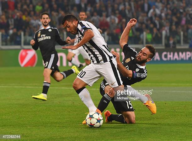 Carlos Tevez of Juventus is fouled by Daniel Carvajal of Real Madrid CF for a penalty during the UEFA Champions League semi final first leg match...