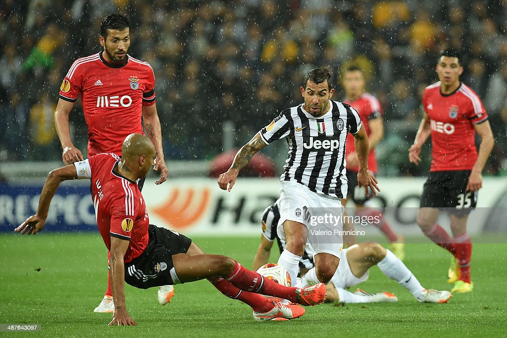 Carlos Tevez (R) of Juventus is tackled by Luisao of SL Benfica during the UEFA Europa League semi-final second leg match between Juventus and SL Benfica at Juventus Arena on May 1, 2014 in Turin, Italy.
