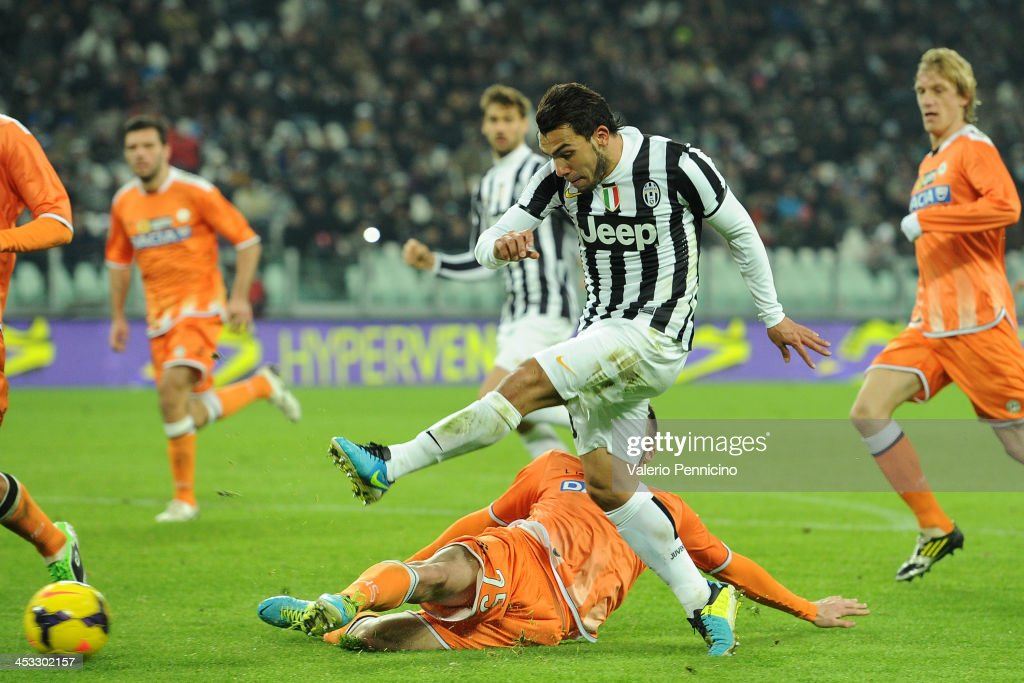 Carlos Tevez of Juventus kicks the ball during the Serie A match between Juventus and Udinese Calcio at Juventus Arena on December 1, 2013 in Turin, Italy.