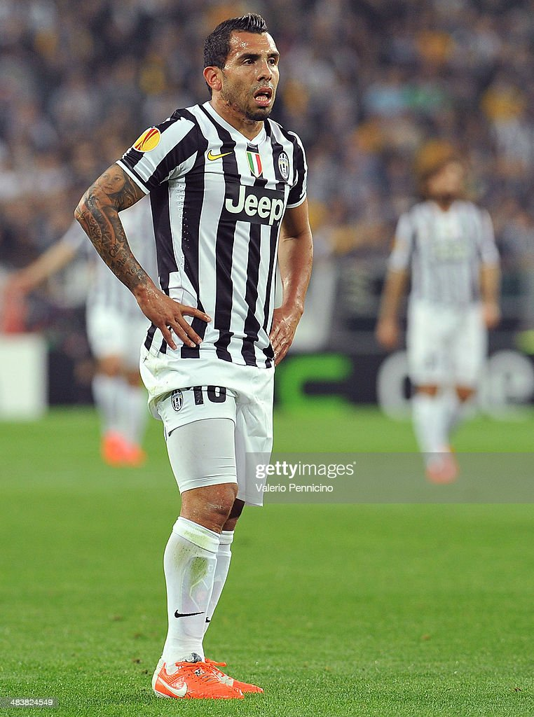 Carlos Tevez of Juventus looks dejected durig the UEFA Europa League quarter final match between Juventus and Olympique Lyonnais at Juventus Arena on April 10, 2014 in Turin, Italy.
