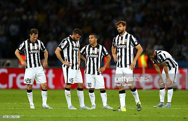 Carlos Tevez of Juventus looks dejected with team mates after the third Barcelona goal by Neymar of Barcelona during the UEFA Champions League Final...