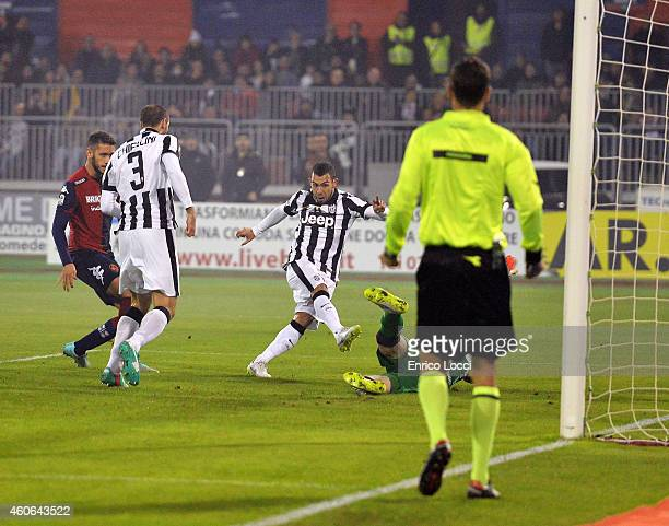 Carlos Tevez of Juventus scored the first goal during the Serie A match against Cagliari Calcio at Stadio Sant'Elia on December 18 2014 in Cagliari...