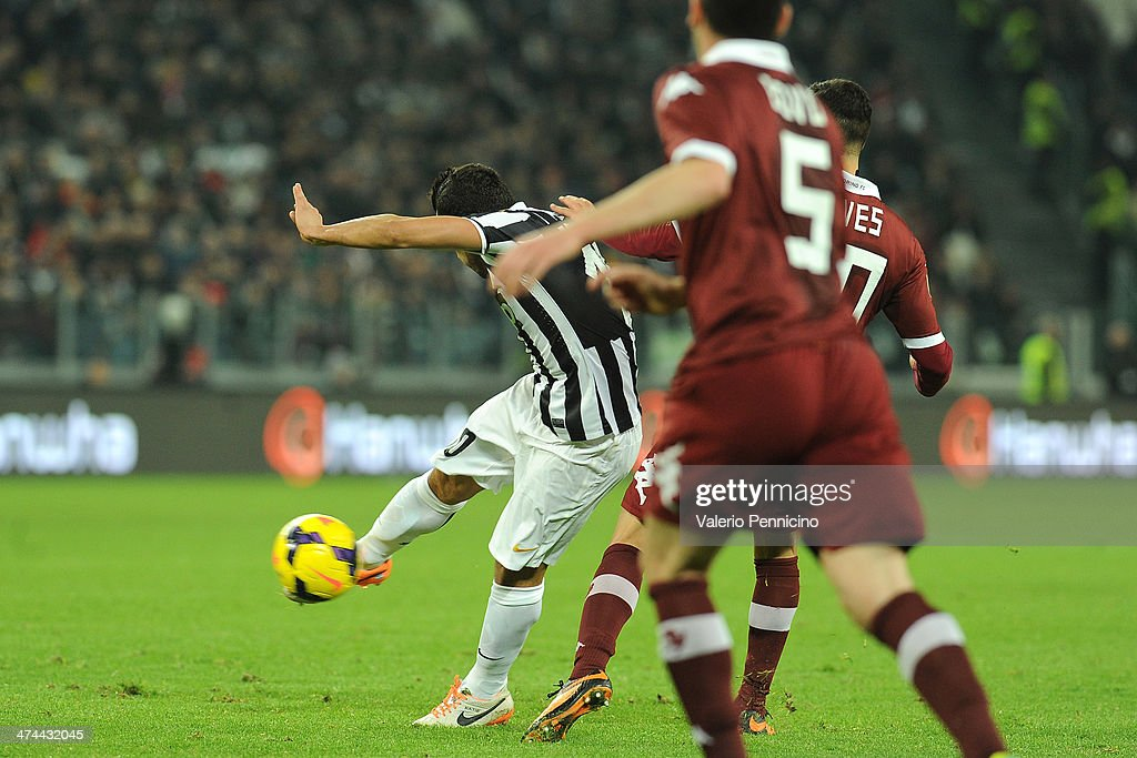 <a gi-track='captionPersonalityLinkClicked' href=/galleries/search?phrase=Carlos+Tevez&family=editorial&specificpeople=220555 ng-click='$event.stopPropagation()'>Carlos Tevez</a> of Juventus scores the opening goal during the Serie A match between Juventus and Torino FC at Juventus Arena on February 23, 2014 in Turin, Italy.