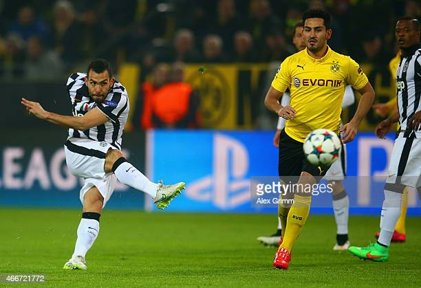 Carlos Tevez of Juventus scores the opening goal during the UEFA Champions League Round of 16 between Borussia Dortmund and Juventus at Signal Iduna...