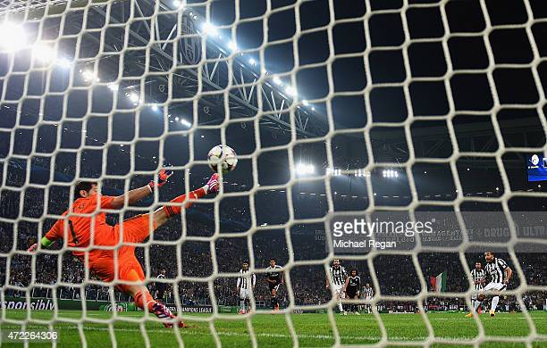 Carlos Tevez of Juventus scores their second goal from a penalty past goalkeeper Iker Casillas of Real Madrid CF during the UEFA Champions League...