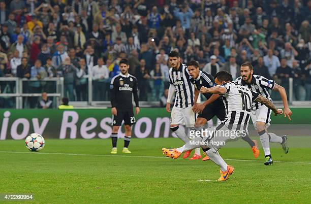 Carlos Tevez of Juventus scores their second goal from a penalty during the UEFA Champions League semi final first leg match between Juventus and...