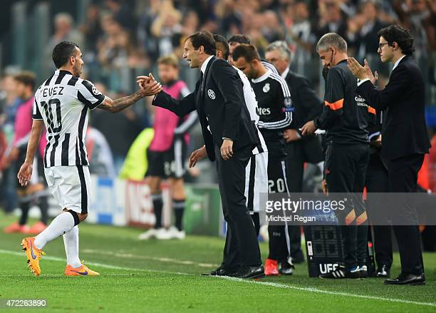 Carlos Tevez of Juventus shakes hands with Massimiliano Allegri manager of Juventus as he is substituted during the UEFA Champions League semi final...
