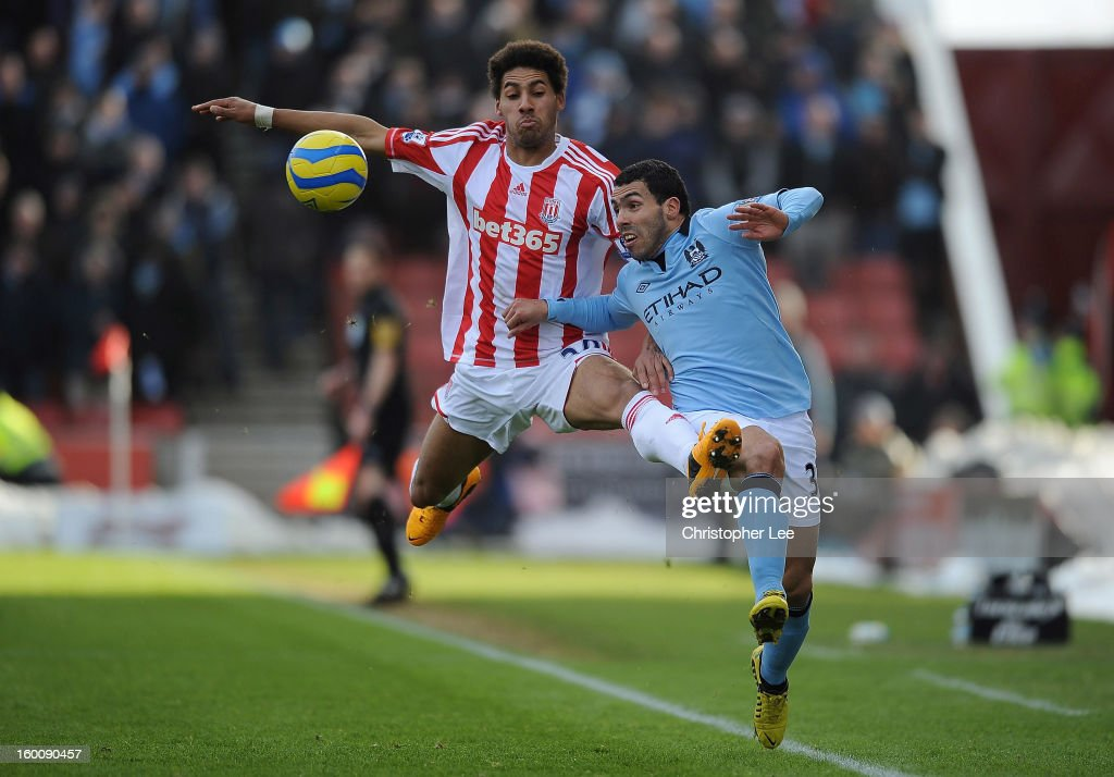 <a gi-track='captionPersonalityLinkClicked' href=/galleries/search?phrase=Carlos+Tevez&family=editorial&specificpeople=220555 ng-click='$event.stopPropagation()'>Carlos Tevez</a> of Man City and Ryan Shotton of Stoke battle for the ball during the FA Cup Fourth Round match between Stoke City and Manchester City at Britannia Stadium on January 26, 2013 in Stoke on Trent, England.