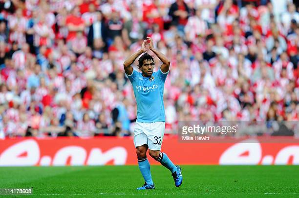 Carlos Tevez of Manchester City applauds his sides fans as he is substituted during the FA Cup sponsored by EON Final match between Manchester City...