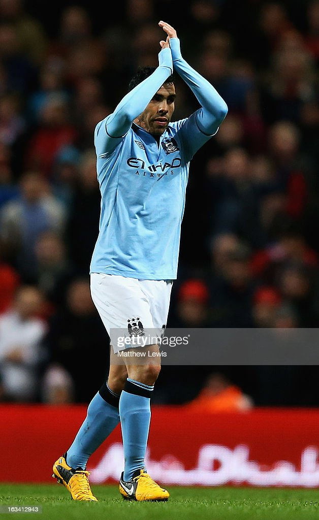 <a gi-track='captionPersonalityLinkClicked' href=/galleries/search?phrase=Carlos+Tevez&family=editorial&specificpeople=220555 ng-click='$event.stopPropagation()'>Carlos Tevez</a> of Manchester City applauds the home fans, after he was substituted during the FA Cup sponsored by Budweiser Sixth Round match between Manchester City and Barnsley at Etihad Stadium on March 9, 2013 in Manchester, England.
