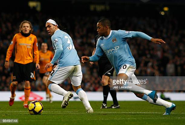 Carlos Tevez of Manchester City back heels the ball to Robinho during the Barclays Premier League match between Manchester City and Hull City at the...