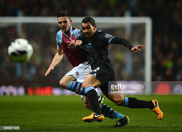 Carlos Tevez of Manchester City battles with Ciaran Clark of Aston Villa during the Barclays Premier League match between Aston Villa and Manchester...
