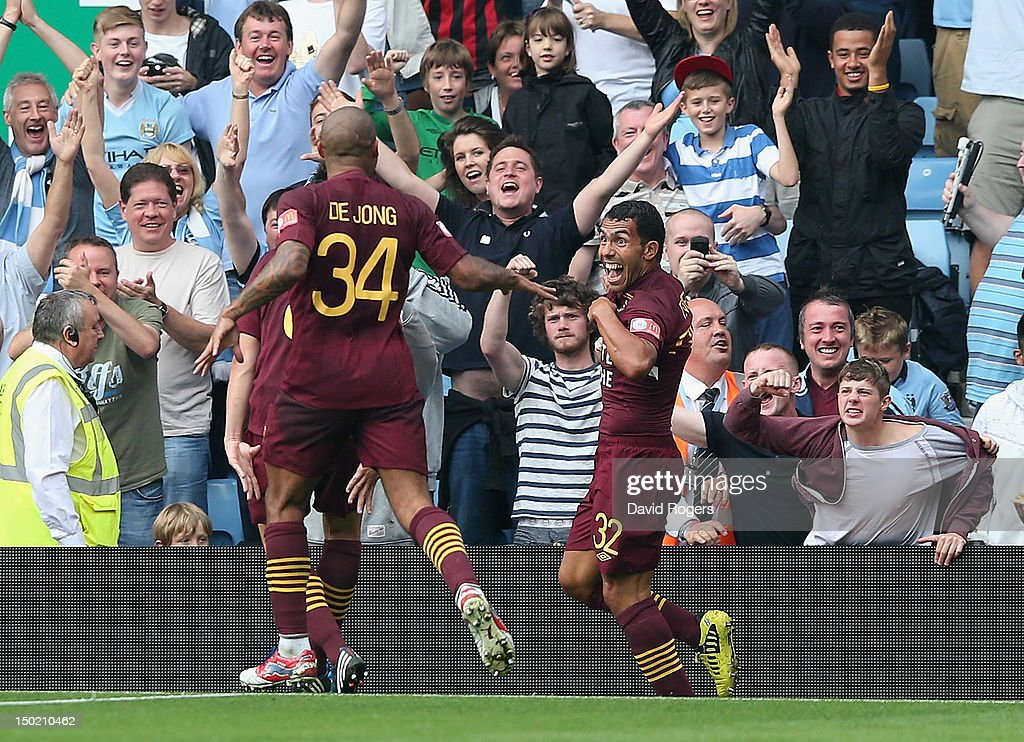 <a gi-track='captionPersonalityLinkClicked' href=/galleries/search?phrase=Carlos+Tevez&family=editorial&specificpeople=220555 ng-click='$event.stopPropagation()'>Carlos Tevez</a> (R) of Manchester City celebrates after scoring a goal during the FA Community Shield match between Manchester City and Chelsea at Villa Park on August 12, 2012 in Birmingham, England.