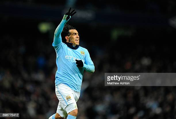Carlos Tevez of Manchester City celebrates after scoring a hat trick to make it 41 by holding up three fingers