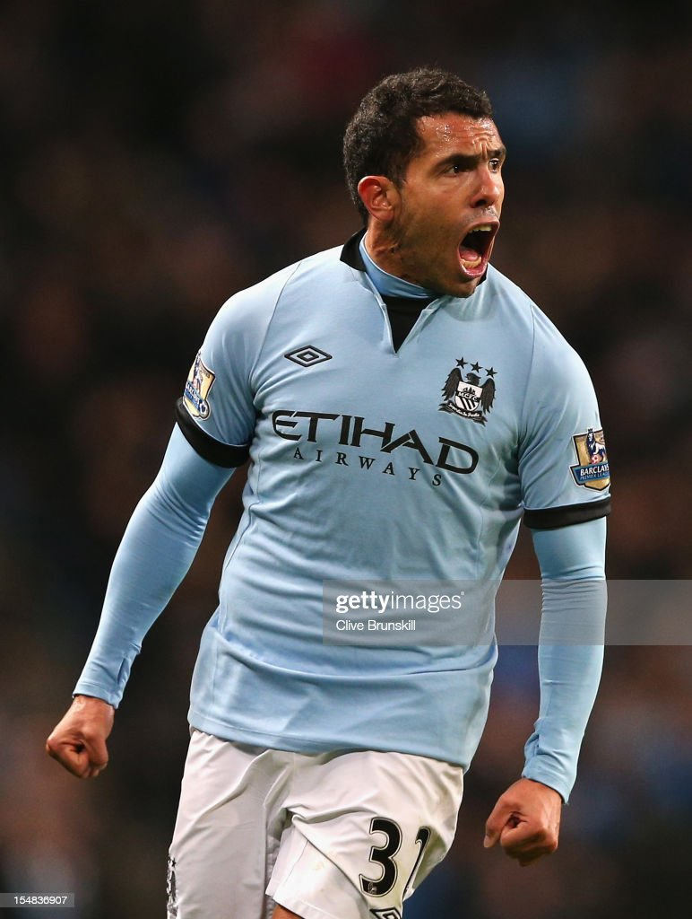 Carlos Tevez of Manchester City celebrates scoring the opening goal during the Barclays Premier League match between Manchester City and Swansea City at the Etihad Stadium on October 27, 2012 in Manchester, England.