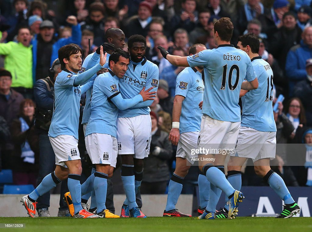 Carlos Tevez of Manchester City celebrates with team mates after scoring the opening goal during the FA Cup sponsored by Budweiser sixth round match between Manchester City and Barnsley at Etihad Stadium on March 9, 2013 in Manchester, England.