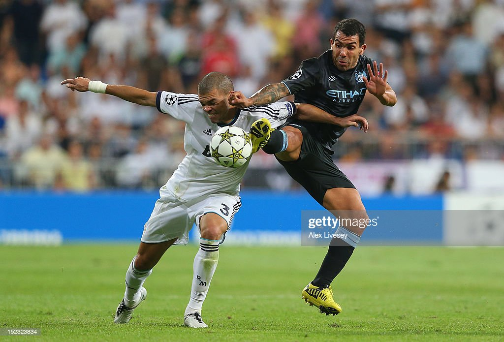 <a gi-track='captionPersonalityLinkClicked' href=/galleries/search?phrase=Carlos+Tevez&family=editorial&specificpeople=220555 ng-click='$event.stopPropagation()'>Carlos Tevez</a> of Manchester City FC tackles Pepe of Real Madrid during the UEFA Champions League Group D match between Real Madrid and Manchester City FC at Estadio Santiago Bernabeu on September 18, 2012 in Madrid, Spain.