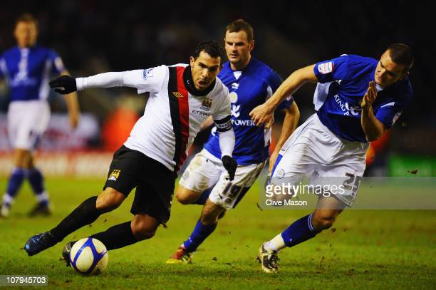 Carlos Tevez of Manchester City holds off the challenge of Jack Hobbs of Leicester City during the FA Cup sponsored by EON 3rd Round match between...