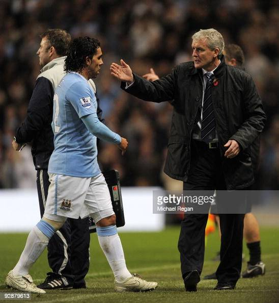 Carlos Tevez of Manchester City is substituted by manager Mark Hughes during the Barclays Premier League match between Manchester City and Burnley at...