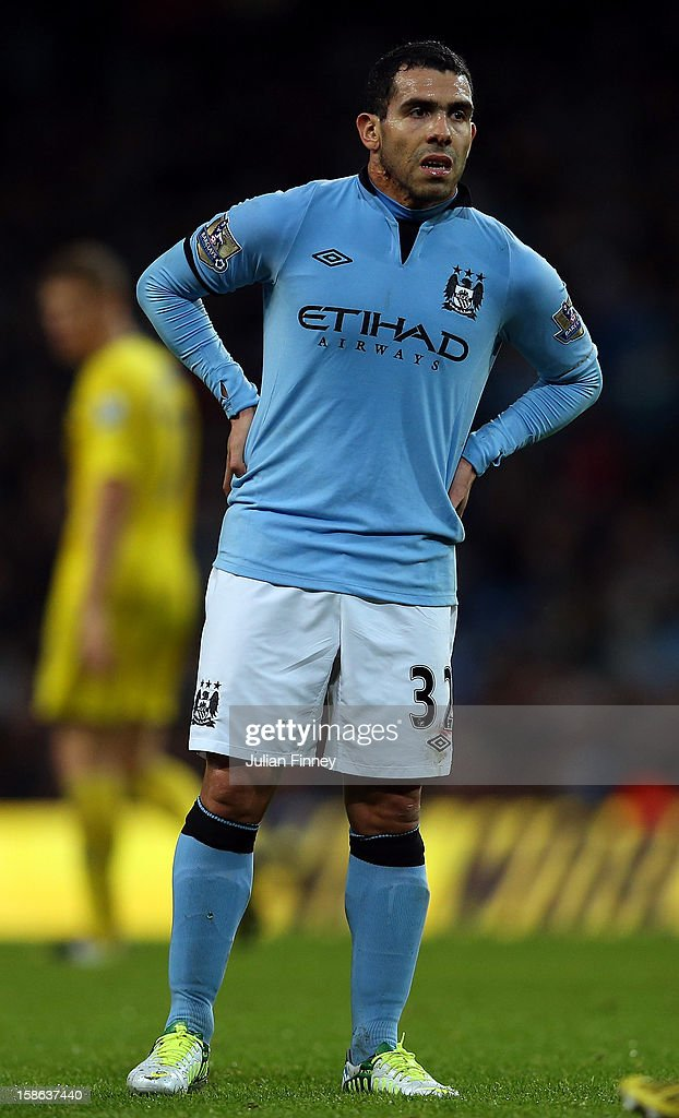 <a gi-track='captionPersonalityLinkClicked' href=/galleries/search?phrase=Carlos+Tevez&family=editorial&specificpeople=220555 ng-click='$event.stopPropagation()'>Carlos Tevez</a> of Manchester City looks on during the Barclays Premier League match between Manchester City and Reading at Etihad Stadium on December 22, 2012 in Manchester, England.