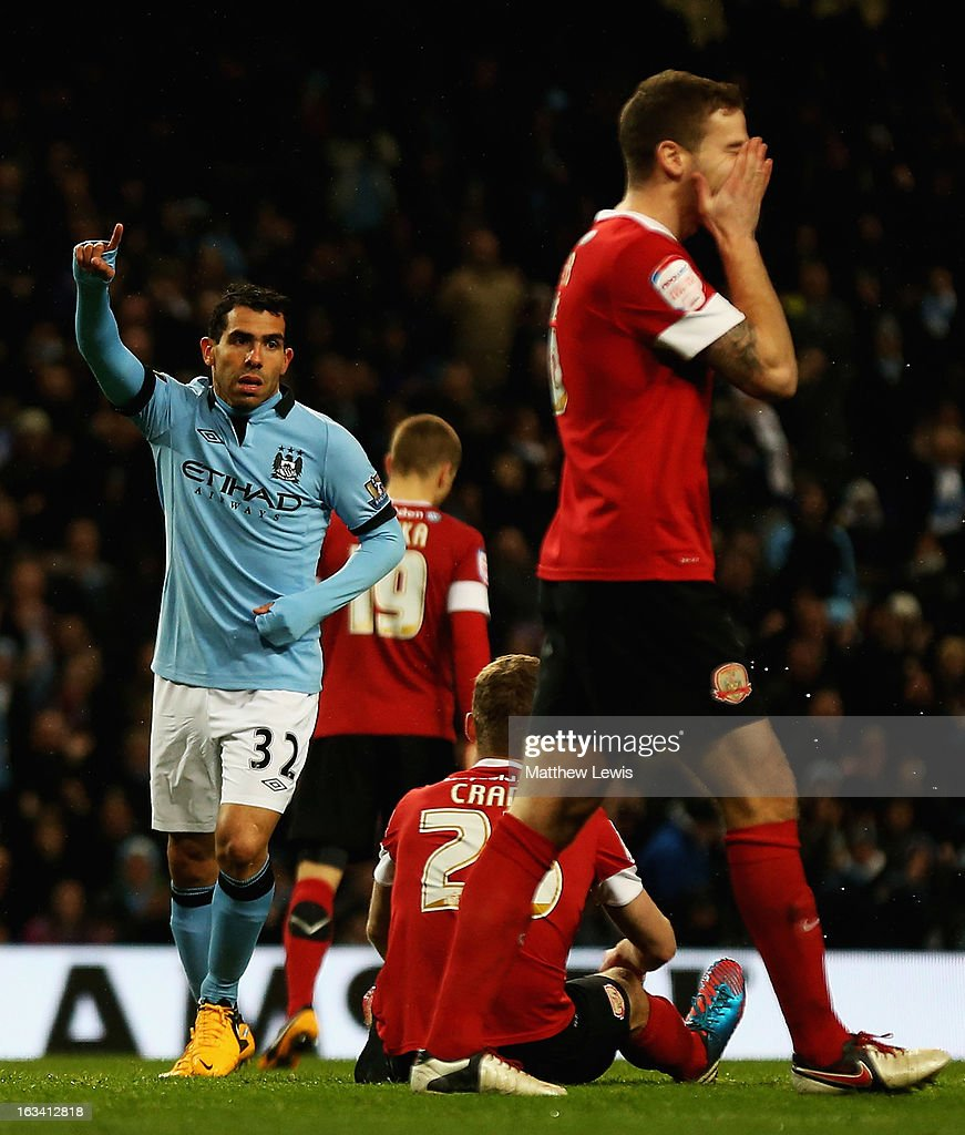 <a gi-track='captionPersonalityLinkClicked' href=/galleries/search?phrase=Carlos+Tevez&family=editorial&specificpeople=220555 ng-click='$event.stopPropagation()'>Carlos Tevez</a> of Manchester City scelebrates scoring his hat trick during the FA Cup sponsored by Budweiser Sixth Round match between Manchester City and Barnsley at Etihad Stadium on March 9, 2013 in Manchester, England.