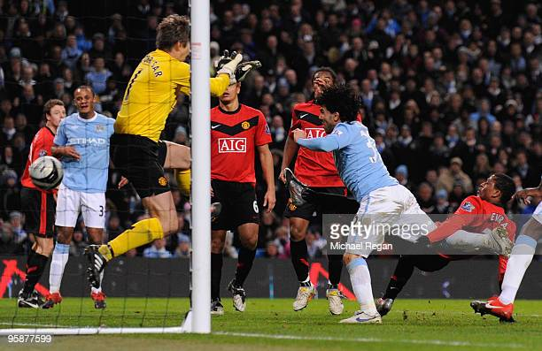 Carlos Tevez of Manchester City scores his team's second goal past Edwin Van der Sar of Manchester United during the Carling Cup Semi Final match...