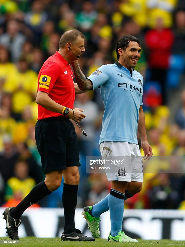 <a gi-track='captionPersonalityLinkClicked' href=/galleries/search?phrase=Carlos+Tevez&family=editorial&specificpeople=220555 ng-click='$event.stopPropagation()'>Carlos Tevez</a> (R) of Manchester City shares a moment with referee <a gi-track='captionPersonalityLinkClicked' href=/galleries/search?phrase=Mark+Halsey&family=editorial&specificpeople=224397 ng-click='$event.stopPropagation()'>Mark Halsey</a> as he is substituted during the Barclays Premier League match between Manchester City and Norwich City at the Etihad Stadium on May 19, 2013 in Manchester, England.