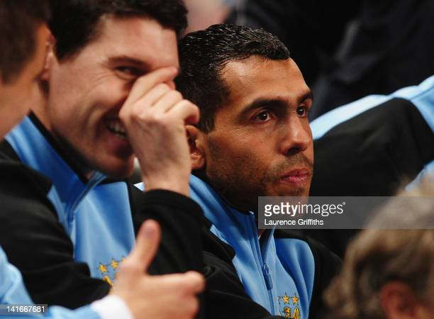 Carlos Tevez of Manchester City sits on the bench alongside Gareth Barry during the Barclays Premier League match between Manchester City and Chelsea...