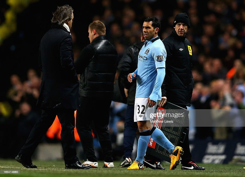 Carlos Tevez of Manchester City talks to <a gi-track='captionPersonalityLinkClicked' href=/galleries/search?phrase=Roberto+Mancini&family=editorial&specificpeople=234429 ng-click='$event.stopPropagation()'>Roberto Mancini</a>, manager of Manchester City, after he was substituted during the FA Cup sponsored by Budweiser Sixth Round match between Manchester City and Barnsley at Etihad Stadium on March 9, 2013 in Manchester, England.